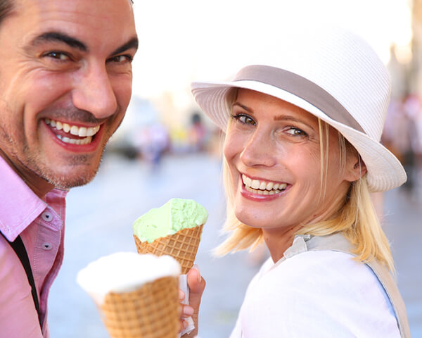 Smiling couple with ice cream cones