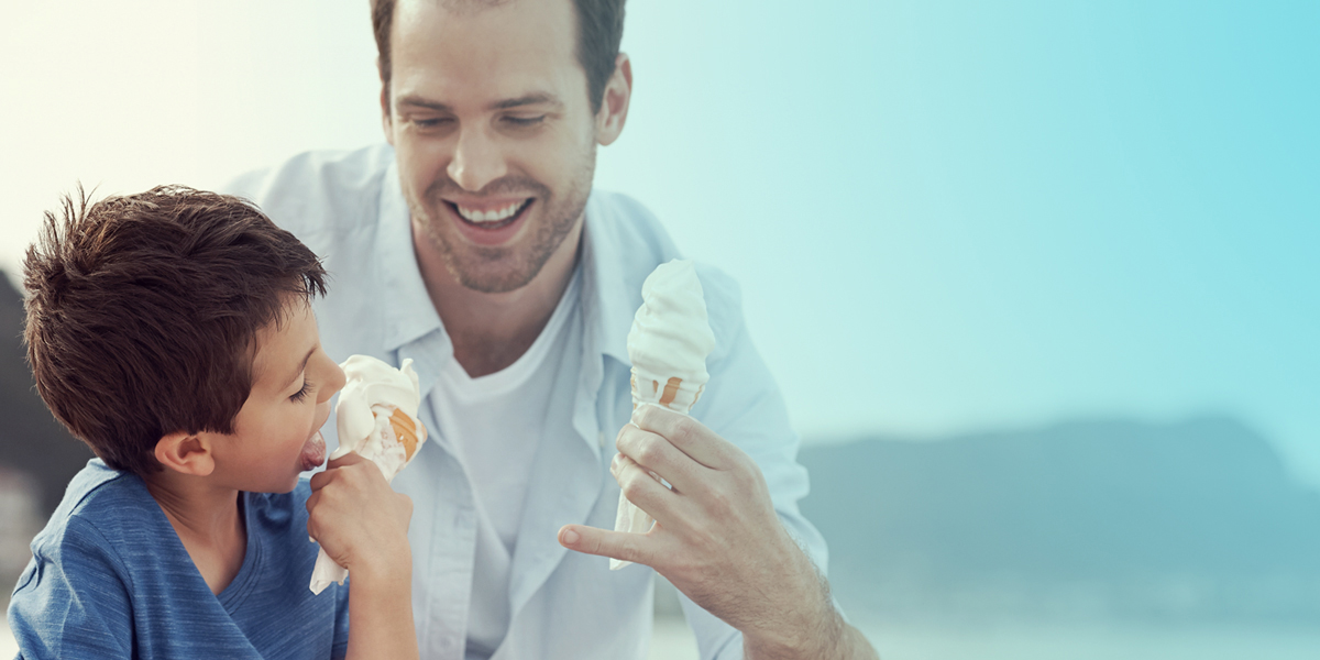 A father and son enjoying Froneri Icecream